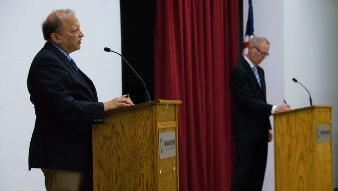 Republican incumbent John Bizon and his Democratic opponent Jim Haadsma participate in a forum for the 62nd state House District at the Kool Family Community Center earlier this month.