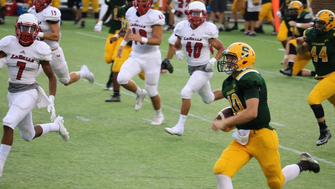 Sycamore senior Jake Borman gets some decent yardage and good field position just before the lightning delay.
