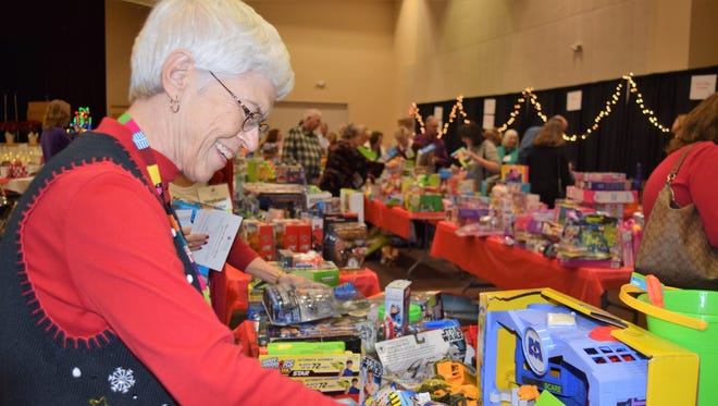 Court Appointed Special Advocate Betty Miller of Scottsdale was one of hundreds of volunteers who collected toys, books, blankets and pajamas for their assigned foster child during Voices for CASA Children's annual Jingle & Mingle event Dec. 16 at El Zaribah Shrine in Phoenix.