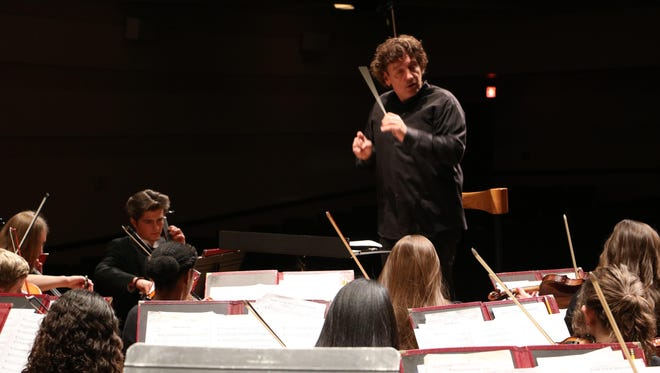 Composer in residence Jim Papoulis directs members of the Great Falls Symphony Youth Orchestra.