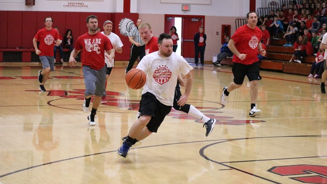 Port Clinton High School and Middle School combined fundraising efforts Redskins style, pitting the staffs of each against one another in a friendly yet competitive charity 'Ball for Lipstraw' basketball game.