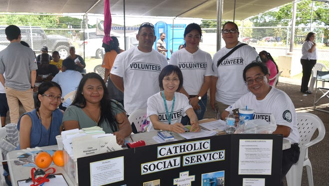 In this April 28 file photo, representatives from Catholic Social Service are ready to be of assistance at Guam Homeless Coalition's Passport to Services at the Hagåtña Community Center.