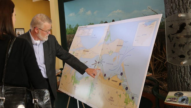 Scudder Mackey, coastal management chief with the Ohio Department of Natural Resources, showcases the 'Sandusky Bay Initiative' project to restore native wetlands.