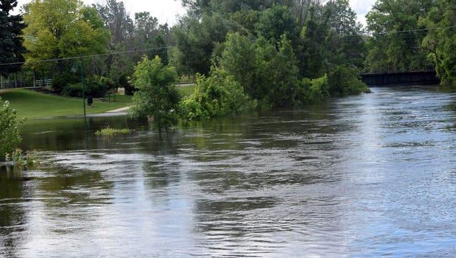 The Pine River flows through Alma, Mich., Monday, June 26, 2017.