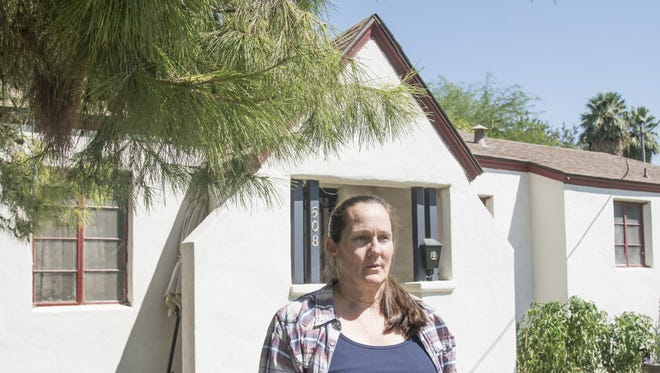 Christine Close stands outsider her historic Mesa house. The West Side-Clark Historic District has been working for 13 years to achieve historic status, and the zoning finally is in effect. The homes, built between 1930 and 1958, are relics of Mesa's pioneers who helped transform the once farm community into the sprawling city it is today.