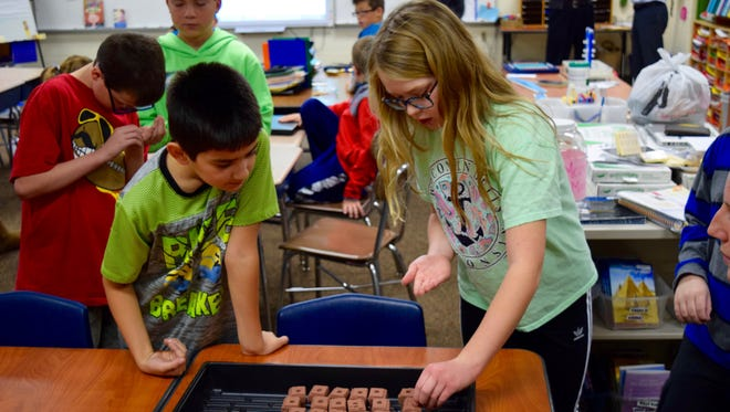 Fifth grade students at Ronald Reagan Elementary plant seeds for their new hydroponic garden. The class researched and planted produce that would grow well in the garden, such as cilantro, peppermint,tomatoes, peppers, and cucumbers.