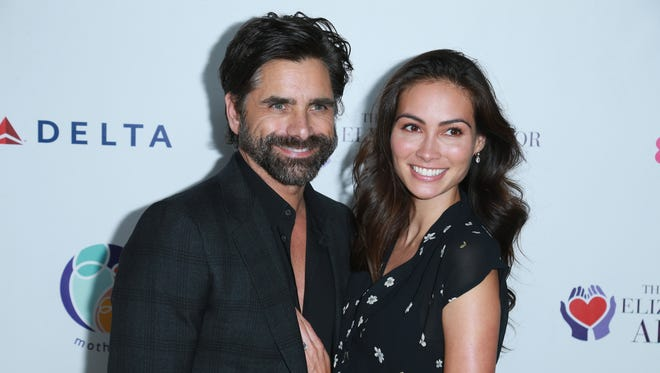 John Stamos and his fiancée Caitlin McHugh,  at a Beverly Hills event in October, are  parents-to-be.
