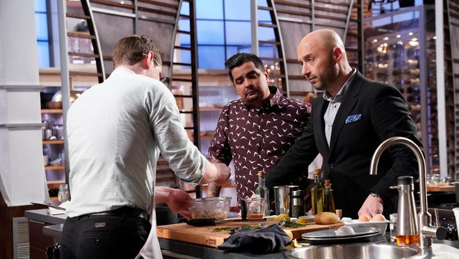 "A contestant and judges Aaron Sanchez and Joe Bastianich on ""MasterChef."""