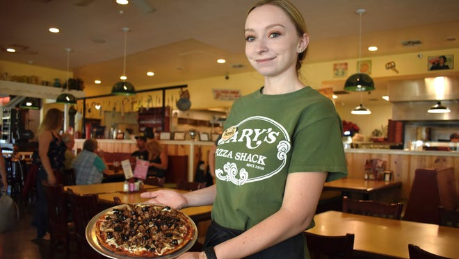 """Server Brenna Fish with a """"bambino""""-size gluten-free pizza at Mary's Pizza Shack in downtown Redding."""