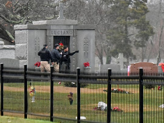 Vineland officers inside of  Sacred Heart Cemetery on E. Walnut Road in Vineland waiting for a man to surrender late afternoon.  Dec. 23, 2015