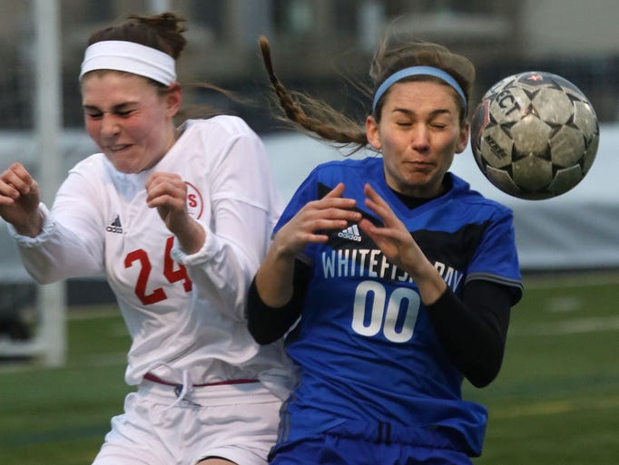 Shorewood's Abbey Drake (24) and Whitefish Bay's Taylor