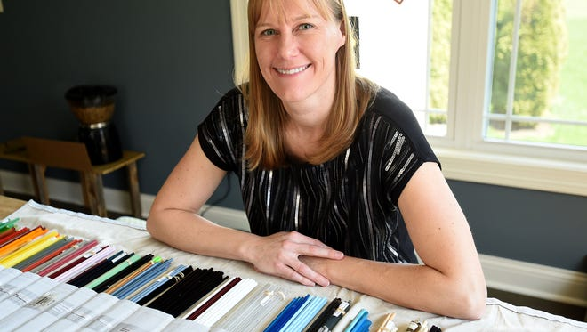 Michelle Korwin-Edson, who earned her Ph.D. in glass science in 2003 and works for Owens Corning, taps in to the artistic side of glass by making glass beads and small glass sculptures from her Granville home.