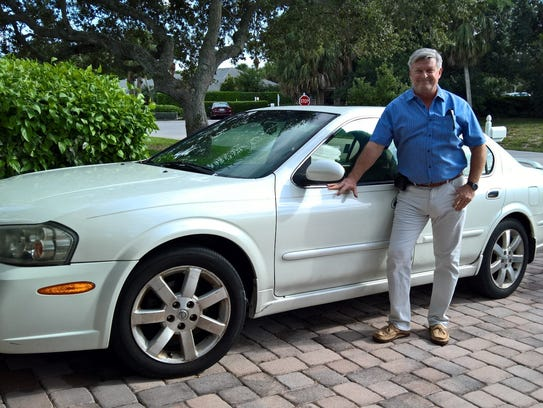 Camp Haven board member Brian Korkus with the Nissan