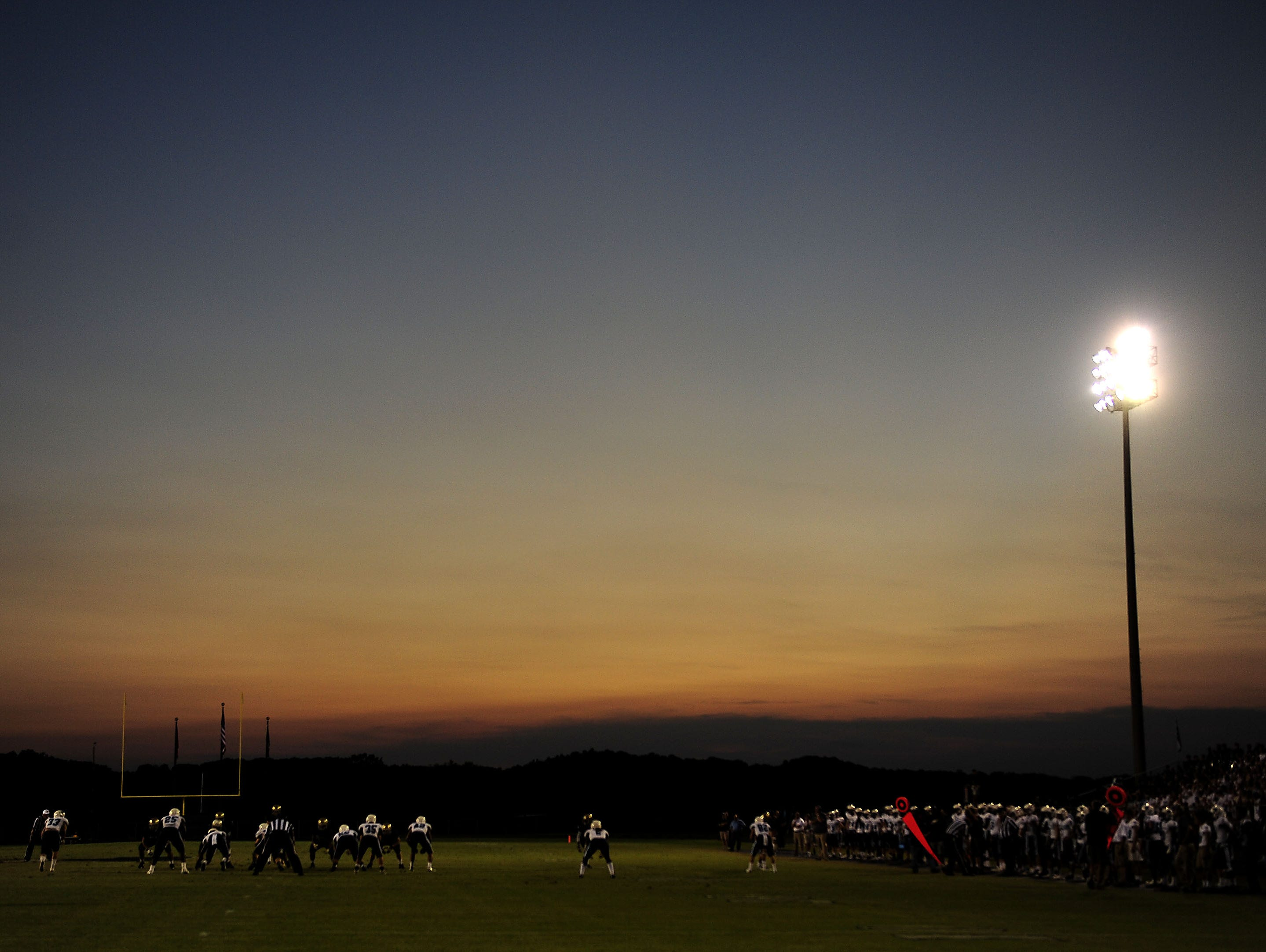 The sun sets in the background during the Centennial and Independence game at Independence High School in Thompson's Station, Tenn., Friday, Aug. 28, 2015.