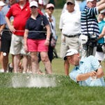 Jul 28, 2016; Springfield, NJ, USA; PGA golfer Bill Haas hits out of a sand trap on the 18th hole during the first round of the 2016 PGA Championship golf tournament at Baltusrol GC - Lower Course. Mandatory Credit: Brian Spurlock-USA TODAY Sports