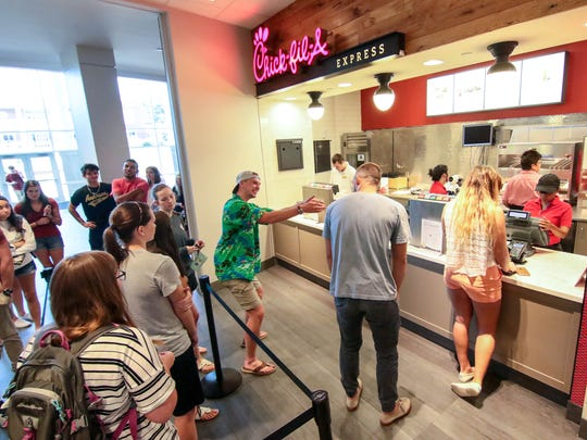 Daniel Baxa (left) gets ready to order food from Chic-fil-A express with his friend Ben Tinsley (right) in the G. Ross Anderson Jr. Student Center in Anderson. The 86,000-square-foot complex, includes space for dining, a banquet hall, a theater, a gym and a gathering spot for student fellowship and study.