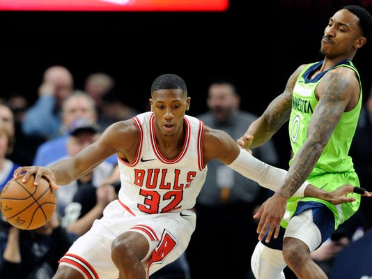 Minnesota Timberwolves' Jeff Teague (0) guards Chicago Bulls' Kris Dunn (32) during the first quarter of an NBA basketball game on Saturday, Feb. 24, 2018, in Minneapolis. (AP Photo/Hannah Foslien)
