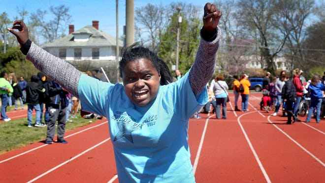Siegel High School student Kristin Jackson celebrates winning her race on Friday, April, 7, 2017, during the Area 16 Special Olympics held at MTSU.