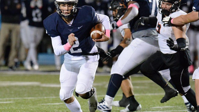 McDowell quarterback Chris Juchno runs against Cathedral Prep at Gus Anderson Field on Oct. 4. Prep won that game 29-26. The archrivals will face each other again Friday at Gus Anderson Field.