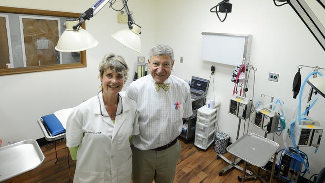 Veterinarians Paula and Charlie Cameron pose inside their practice, Eastern Shore Animal Hospital, in Painter. Dr. Charlie Cameron has been the head veterinarian for the Chincoteague wild pony herd since 1990.