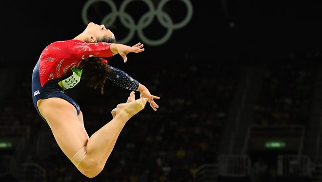 Laurie Hernandez of Old Bridge performs on the balance beam during women's gymnastic qualifications in the Rio 2016 Summer Olympic Games at Rio Olympic Arena on Sunday, Aug. 7.