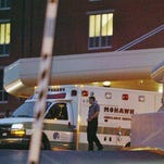 An ambulance transporting prison escapee David Sweat arrives at Albany Medical Center on Sunday.