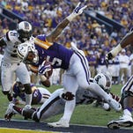 LSU running back Derrius Guice (5) scores a touchdown during the second half of an NCAA college football game against South Carolina in Baton Rouge.