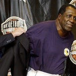 """FILE - In this Sept. 5, 2003, file photo, Basketball Hall of Fame CEO John Doleva, left, presents a Hall of Fame jacket to inductee Meadowlark Lemon, of the Harlem Globetrotters, at the Basketball Hall of Fame in Springfield, Mass. Lemon, known as the Globetrotters' """"clown prince"""" of basketball, died Sunday, Dec. 27, 2015, in Scottsdale, Ariz. He was 83."""