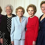 FILE - In this Jan. 17, 2003 file photo, former first ladies get together for a group photo at a gala 20th anniversary fundraising event saluting Betty Ford and the Betty Ford Center in Indian Wells, Calif. From left are Rosalynn Carter, Barbara Bush, Betty Ford, Nancy Reagan and Sen. Hillary Rodham Clinton. Former first lady Nancy Reagan, whose funeral service scheduled for Friday, March 11, 2016, was planned down to the smallest details by the former first lady herself. Scheduled to attend are former president George W. Bush and his wife Laura Bush, former first ladies Rosalynn Carter and Sen. Hillary Clinton, and first lady Michelle Obama.