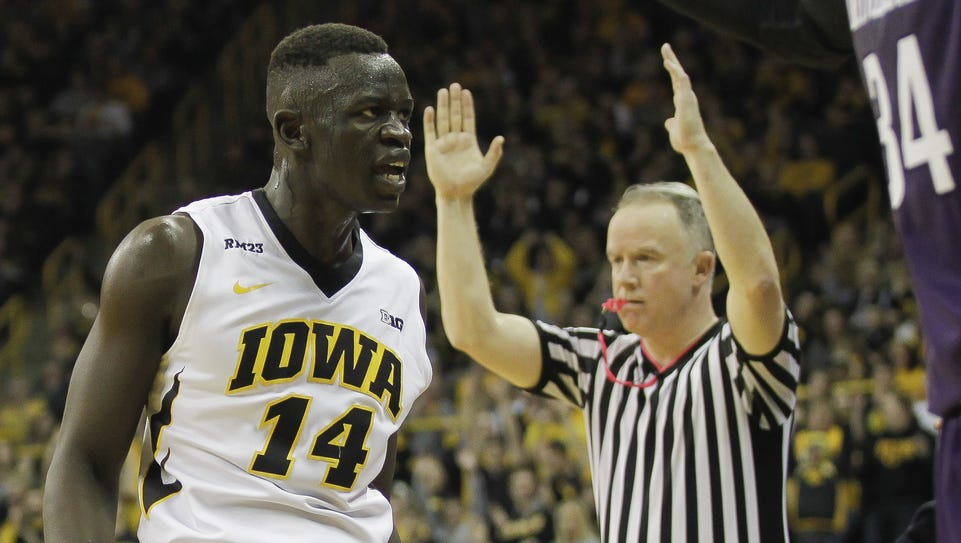 Iowa guard Peter Jok reacts after hitting his third