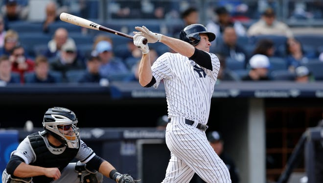 New York Yankees Chase Headley hits a seventh-inning, RBI double in a baseball game against the Chicago White Sox in New York, Sunday, May 15, 2016.