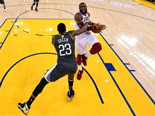 June 3: LeBron James drives to the basket against Draymond