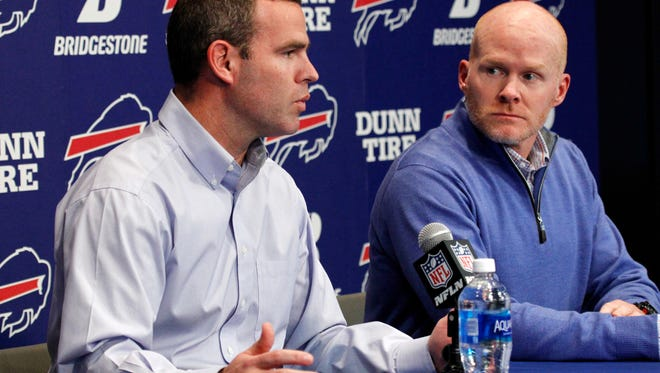 Buffalo Bills general manager Brandon Beane, left, and head coach Sean McDermott, found a way to bring back defensive tackle Kyle Williams for one more season.