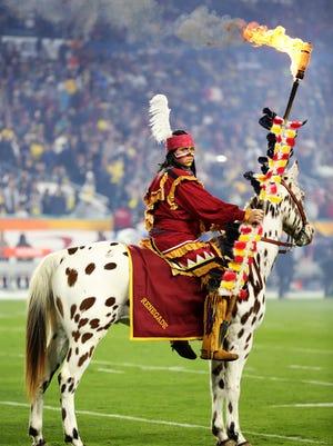 Florida State Seminoles mascots Osceola and Renegade .