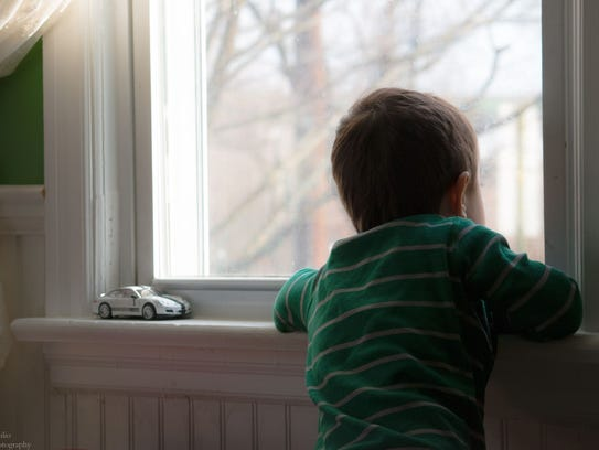 Gabriel Neilio watches for snow plows in Gloucester
