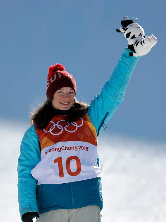 Gold medal winner Sarah Hoefflin, of Switzerland, celebrates after the women's slopestyle finals at Phoenix Snow Park at the 2018 Winter Olympics in Pyeongchang, South Korea, Saturday, Feb. 17, 2018. (AP Photo/Gregory Bull)