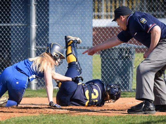 Northern Lebanon's Haley Fegle is tagged out after colliding with Elco catcher Madi Groy at the plate. The Raiders and Northern Lebanon met at Elco on Wednesday. Elco had to overcome a 4-0 first-inning deficit to defeat the Vikings, 8-6.