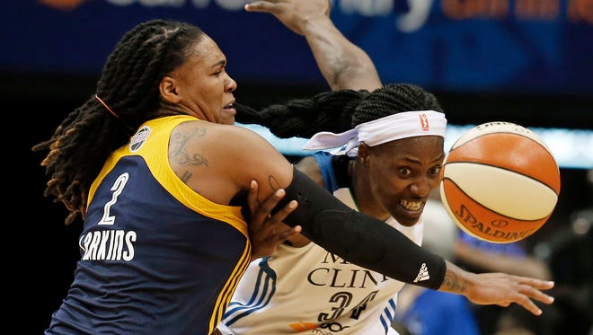 Indiana Fever's Erlana Larkins, left, tries to keep Minnesota Lynx's Sylvia Fowles away from the ball in the second half in Game 1 of the WNBA basketball finals, Sunday, Oct. 4, 2015, in Minneapolis. The Fever won 75-69. (AP Photo/Jim Mone)