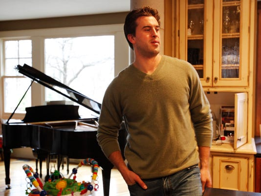 In this Dec. 13, 2011, file photo, former NFL tight end Ben Utecht stands in his Lakeville, Minn., home. Utecht, who earned a Super Bowl ring in 2006 with the Colts, left the NFL in 2009 after an injury settlement with the Bengals. The players' union filed a grievance so that he could get his entire salary, and won. Since then, he's worked on his music and has been one of the leading advocates on behalf of current and former players' recognition, treatment and medical coverage of concussions and head trauma. He's currently a spokesman for the American Academy of Neurology and testified before Congress in August about concussion issues. (AP Photo/Star Tribune, David Joles)