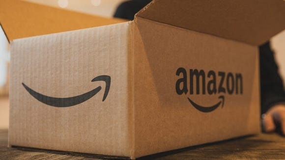 An Amazon box, opened, sitting on a table