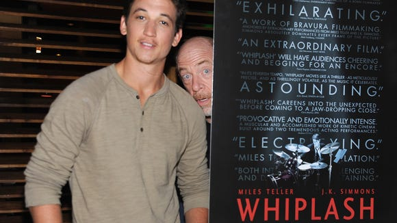"""Actors J.K. Simmons (right) and Miles Teller attend a screening of """"Whiplash"""" in Los Angeles earlier this year."""