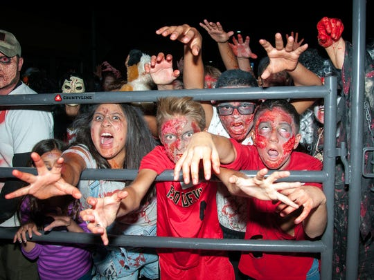 "A group of ""zombies"" wait to be released from quarantine"