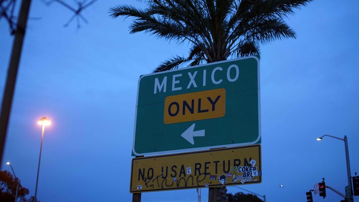 A street sign leading into Mexico at the U.S.-Mexico