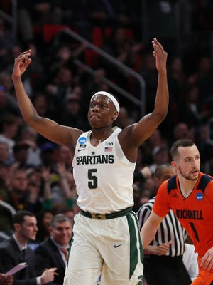 Michigan State's Cassius Winston celebrates a 3-pointer in the first half against Bucknell in the first round of the 2018 NCAA tournament at Little Caesars Arena in Detroit, Friday, March 16.