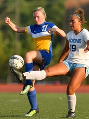 Rielyn Hamilton gets a toe to a loose ball for Boone County as Newport Catholic's Jalyn Vogt defends at Dixie Heights High School Friday, August 11th