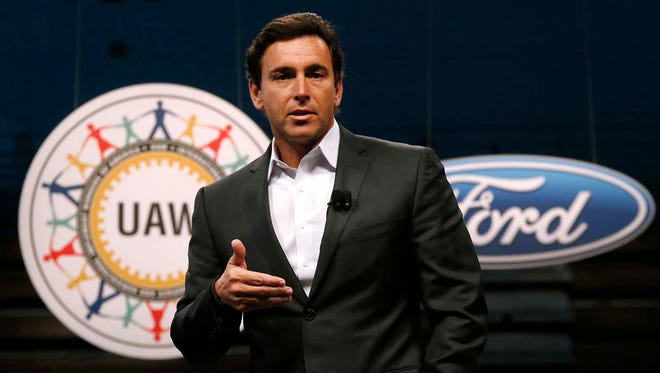 On July 23, 2015, Ford Motor Company President and CEO Mark Fields speaks during a ceremony to mark the opening of contract negotiations with the United Auto Workers in Detroit. Fields said Tuesday, Aug. 16, 2016, that Ford Motor Co. will have a fully autonomous vehicle ready to provide ride-hailing or ride-sharing services by 2021. (AP Photo/Paul Sancya, File)