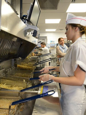Carlie Underwood handles the fry station Oct. 27, 2016, during Tasty Made's grand opening in Lancaster. The Lancaster location was the first in the country for the Chipotle Mexican Grill-owned fast food restaurant. But the company announced that Wednesday would be it's last day in operation.