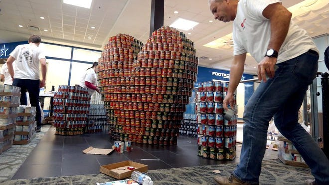 GABE HERNANDEZ/CALLER-TIMES Members of LNV Inc. build a structure during Canstruction in 2016 at La Palmera Mall.