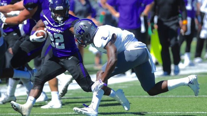 Joey D. Richards/Reporter-News Abilene Christian running back De'Andre Brown (22) stiff arms Central Arkansas' Devin Spurlock (2) during their game Oct. 1, 2016 at Shotwell Stadium.