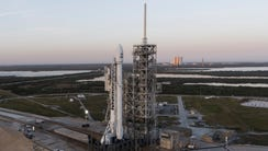 SpaceX's flight proven Falcon 9 rocket stands on pad